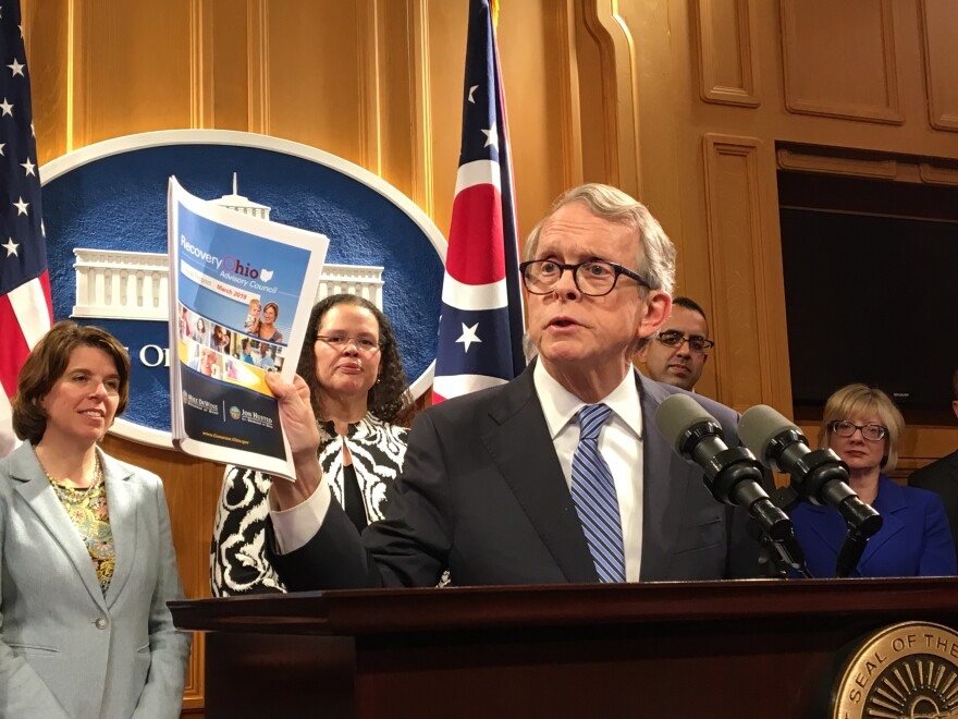 dewine_with_report.jpg