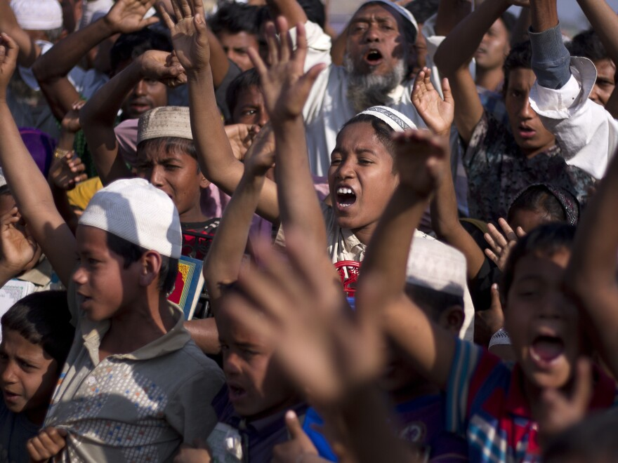 Rohingya children and refugees raise their hands and shout that they won't go back to Myanmar during a demonstration at Kutupalong near Cox's Bazar, Bangladesh, last month.
