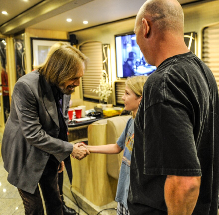 Jason and Connor Enright with Tom Petty in 2013.