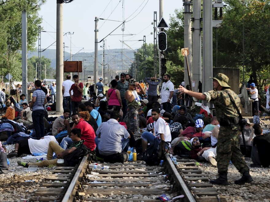 Macedonian special police guard the border as more than a thousand migrants wait at Macedonia's border with Greece.