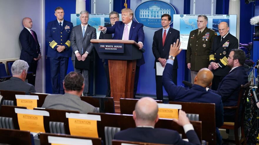 President Trump takes questions from the press during a briefing on April 1, after announcing enhanced drug operations.