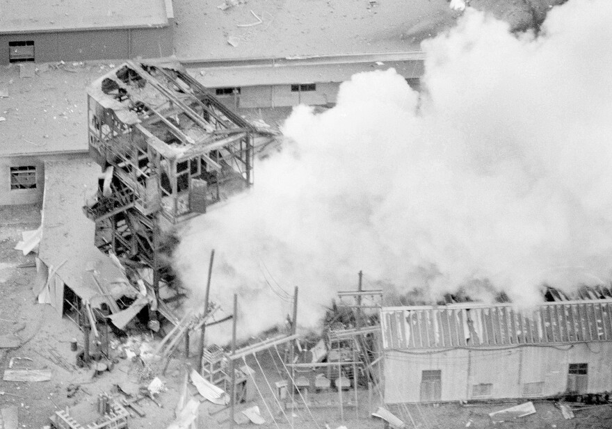 In this Nov. 21, 1968, file photo, smoke pours from the burning Llewellyn portal of the Mountaineer Coal Co., where 78 miners are trapped near Farmington, W.Va.