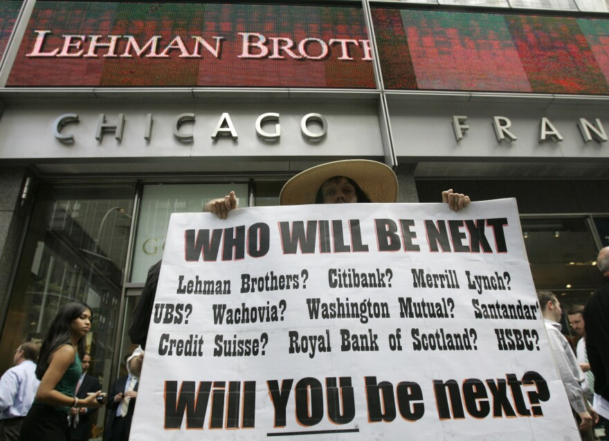 Robin Radaetz holds a sign in front of the Lehman Brothers headquarters in 2008 in New York. Lehman Brothers' Chapter 11 declaration was the biggest bankruptcy filing ever at the time.