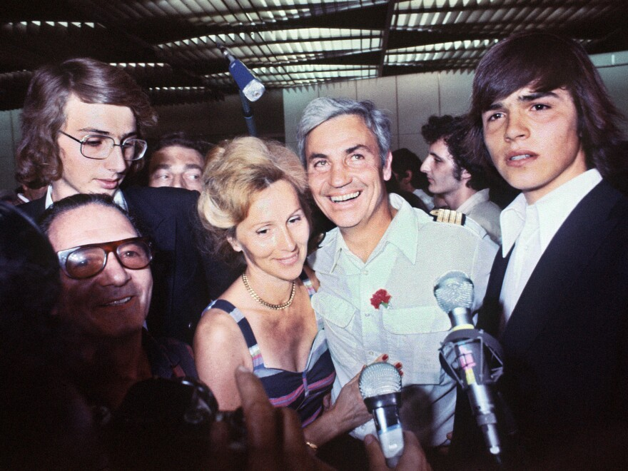 Pilot Michel Bacos was greeted by his wife at Orly Airport on July 5, 1976 in Paris, France after refusing to abandon his Jewish passengers held hostage by Palestinian and German terrorists.