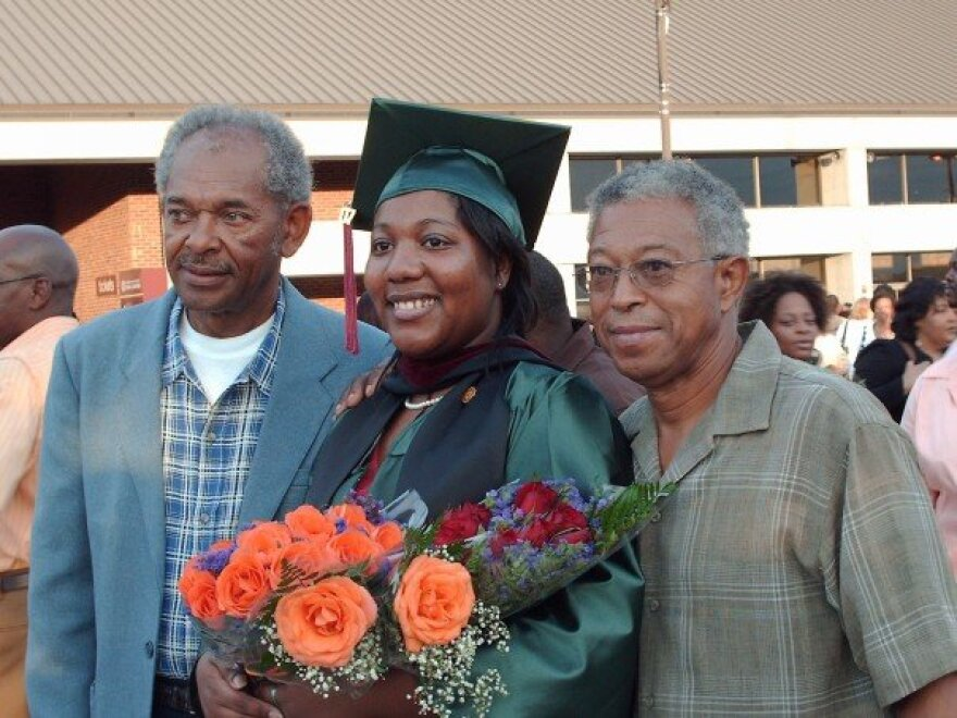 Lynn and her grandpa's. Photo taken graduation day, August 2007 at the Leon County Civic Center.