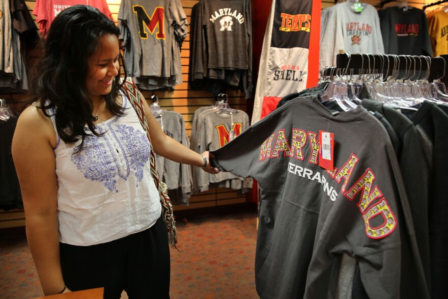 Alejandra Gonzalez browses in the bookstore at the University of Maryland in College Park, Md.