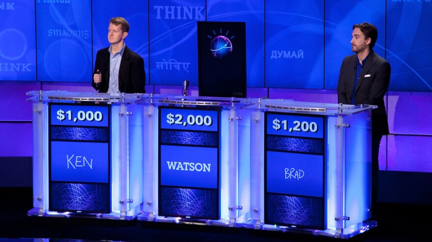 """""""Jeopardy!"""" contestants Ken Jennings and Brad Rutter compete against Watson at a press conference in January. Soon Watson could be giving answers to your doctor's questions."""