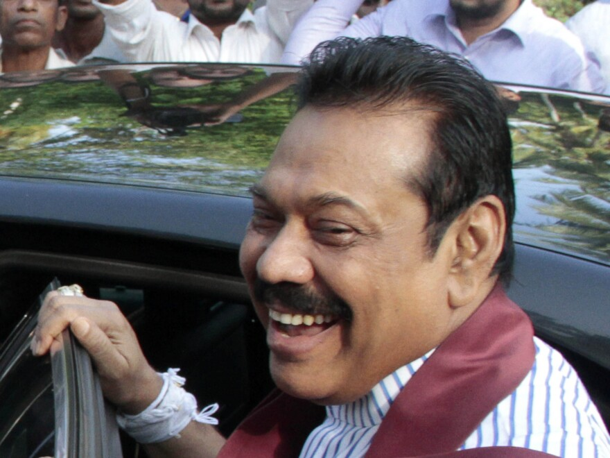 Sri Lankan President Mahinda Rajapaksa after casting his ballot in last week's election. The new government says that contrary to reports of a peaceful transition when Rajapaksa lost, the long-time leader tried to stay in power by force.