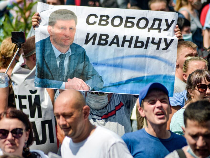 People carry a banner demanding freedom for Furgal during a demonstration in Khabarovsk on July 18.