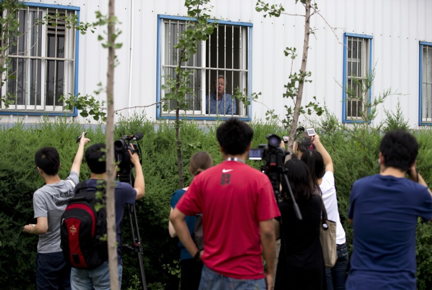 American Chip Starnes, co-owner of Specialty Medical Supplies, spoke to the media Tuesday from a window at a factory on the outskirts of Beijing.