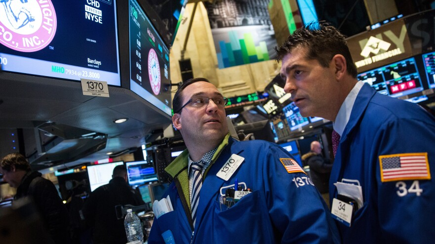 Traders work on the floor of the New York Stock Exchange on Tuesday afternoon.