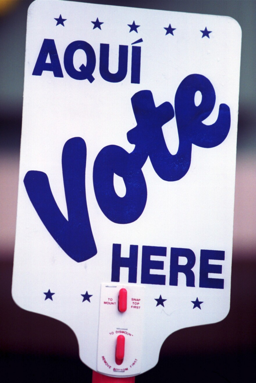 <p>A sign in Spanish and English tells residents of El Paso, Texas, where to vote.</p>
