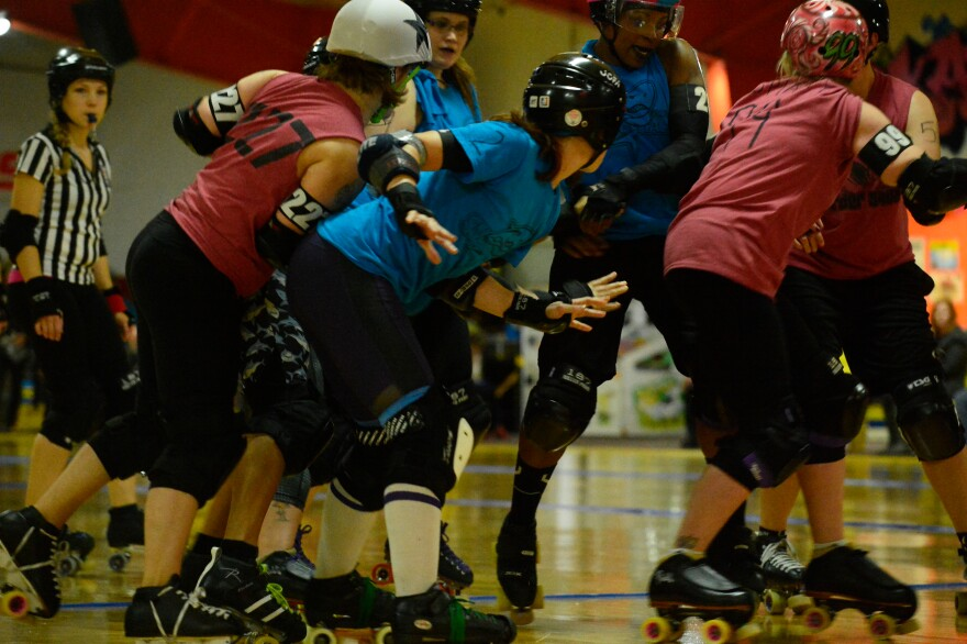 Gem City Roller Derby teams Snark Attack and Murder Squad in a pack at the last bout of the year.