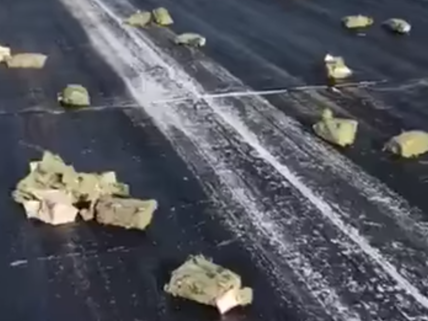 Gold bars that fell on the runway at an airport in Siberia on Thursday.