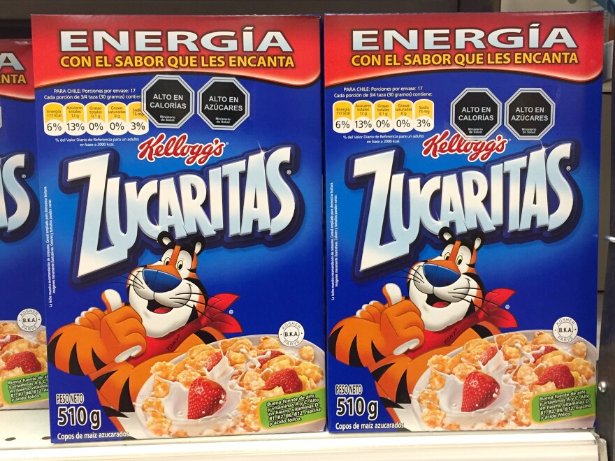 Tony the Tiger looks blissfully unaware of the nutritional warnings floating above his head.