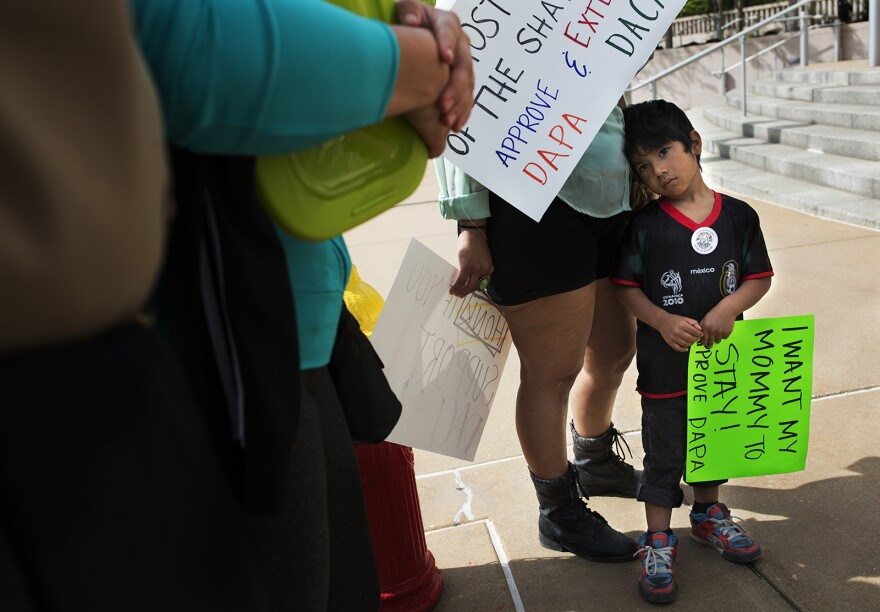 Jitzak Mejia, 4, holds a sign during an earlier rally in support of immigration reform at the federal courthouse in St. Louis.