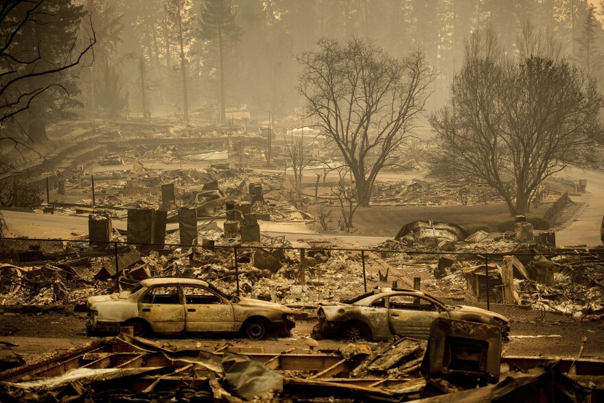 The Camp Fire destroyed whole blocks of Paradise, Calif., leaving behind charred chimneys and walls standing amid smoldering ashes.