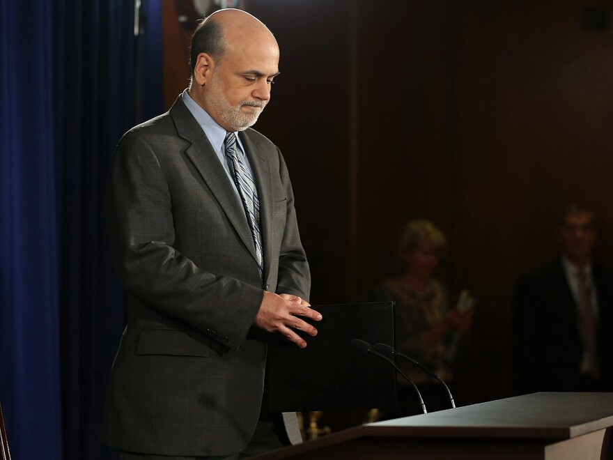 Federal Reserve Chairman Ben Bernanke arrives to speak at a news conference Wednesday in Washington, D.C. The Fed cut its economic growth forecasts and said it would keep buying bonds in a bid to keep interest rates down.