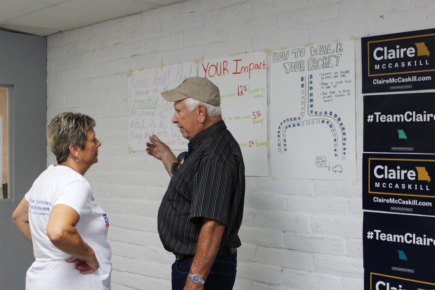 Patrice Billings listens to a prospective voter in the coordinated campaign office before heading out to canvass.
