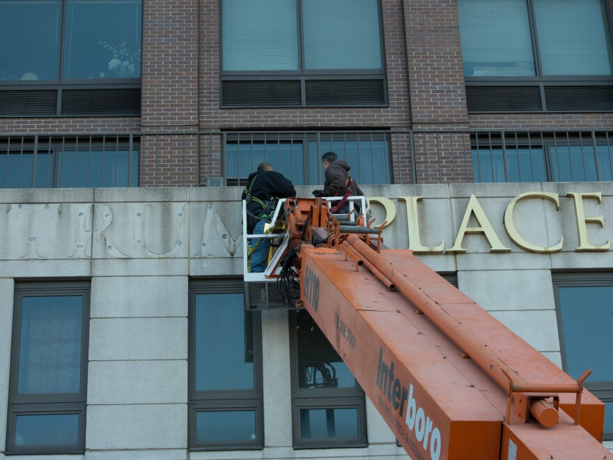 Workers remove Trump signage from Trump Place on Riverside Boulevard. on Manhattan's West Side on Nov. 16, 2016. A separate building nearby won a judge's permission to remove Trump's name if enough residents agree.