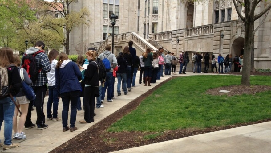 Students wait to pass through a security checkpoint at the University of Pittsburgh's Cathedral of Learning on Tuesday. Security has tightened at the school after a string of false bomb threats on the campus.