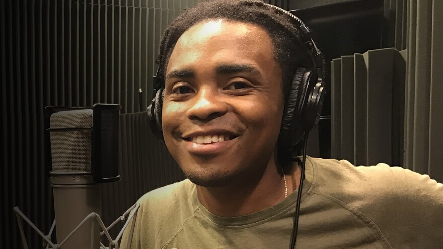 Man Smiling with the headphones on