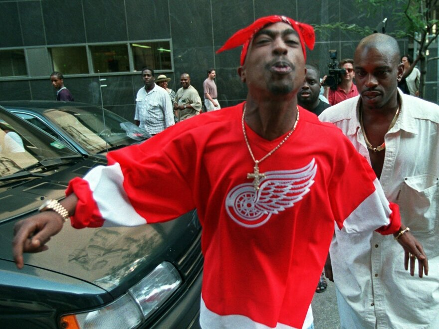 Shakur spits in the direction of reporters as he leaves state Supreme Court in New York on July 5, 1994.