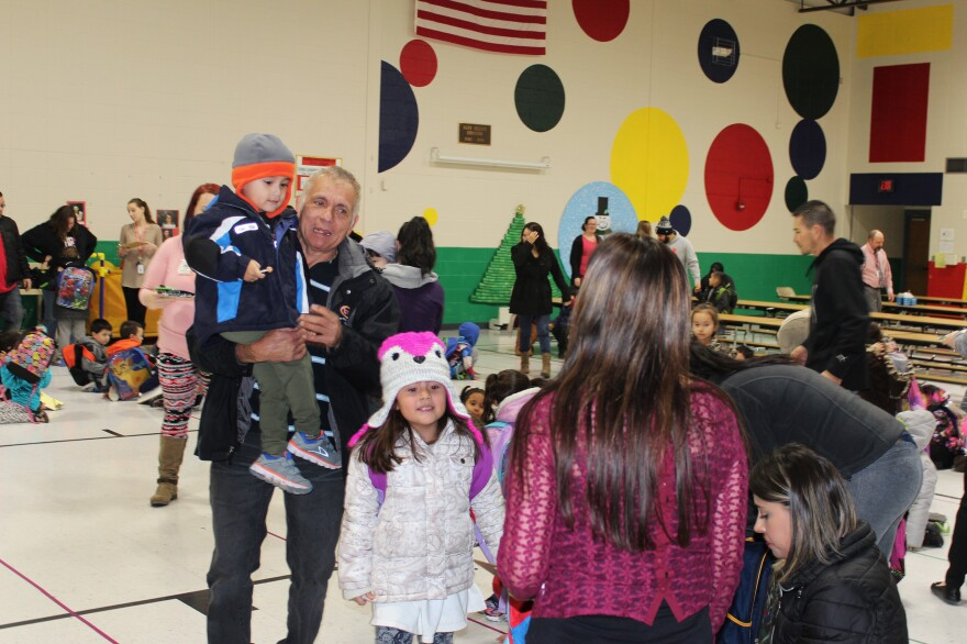 Parents pick up their kids from  Garfield Early Childhood Center, a pre-K facility serving all children in the district. Burmese, Mandarin, Arabic, and many Spanish dialects are among at least 27 languages spoken at home by children in the district.