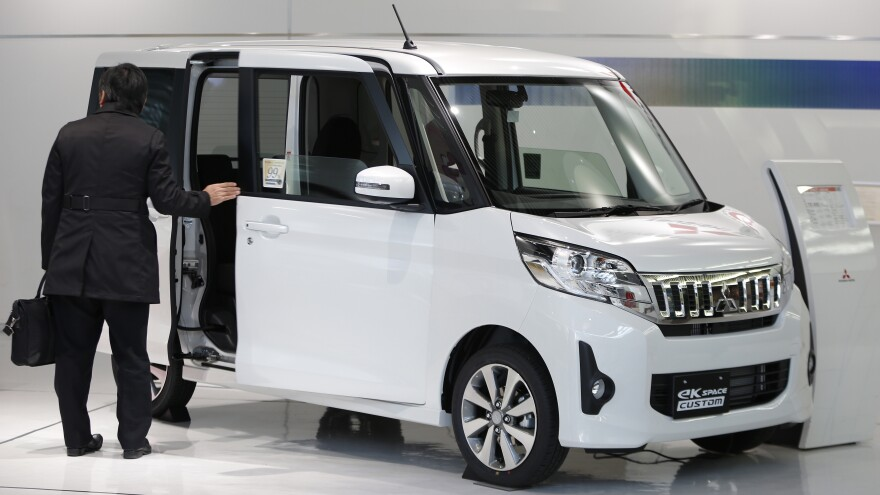 Mitsubishi Motors says its employees manipulated fuel consumption data on its eK Space and other vehicles — and that it won't sell them until the problems are fixed. Here, a custom version of the eK Space is seen at a 2014 auto show.