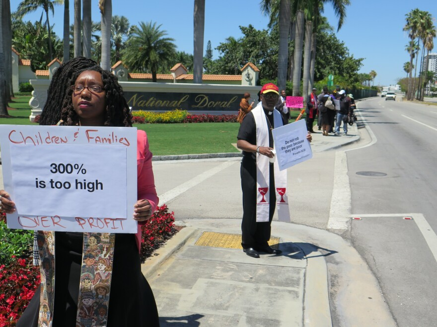 The Rev. Sekinah Hamlin (left) of Greensboro, N.C., and the Rev. Dr. Jack Sullivan Jr., of Findlay, Ohio, were among the faith leaders protesting outside the payday lenders conference near Miami.