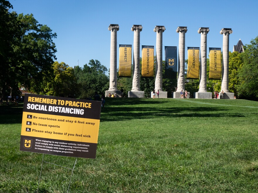 A sign on the Francis Quadrangle at the University of Missouri in Columbia reminds students to maintain social distancing.