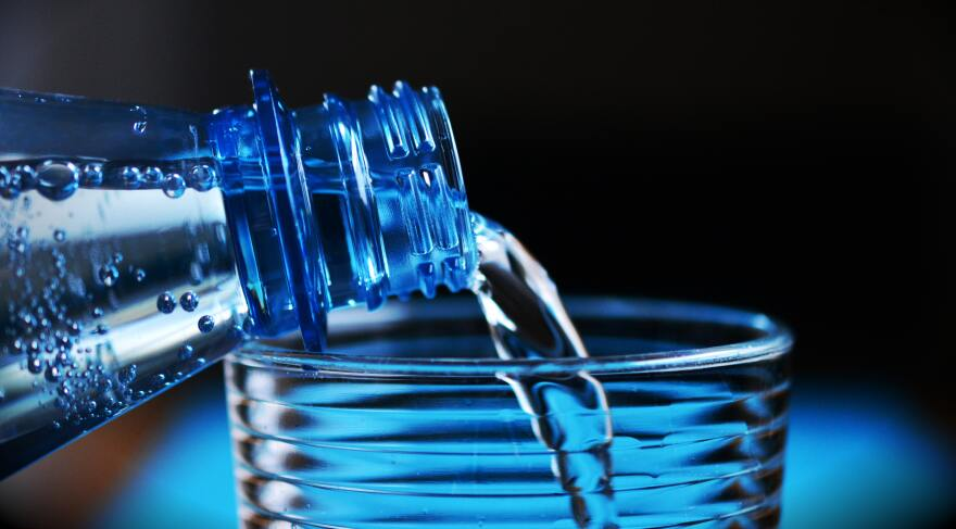 close-up-of-bottle-pouring-water-on-glass-327090_1.jpg