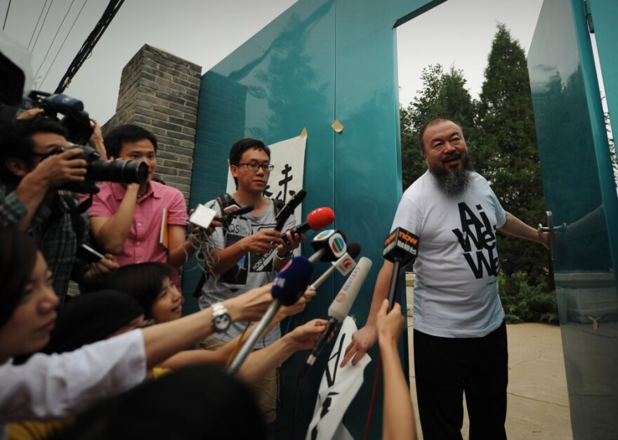 <p>Outspoken Chinese artist Ai Weiwei arrives to speak to reporters outside his studio in Beijing in June of 2011.</p>