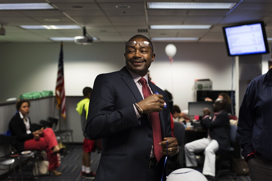 St. Louis Public Schools Superintendent Kelvin Adams watches as early results come in showing strong support for Proposition 1.