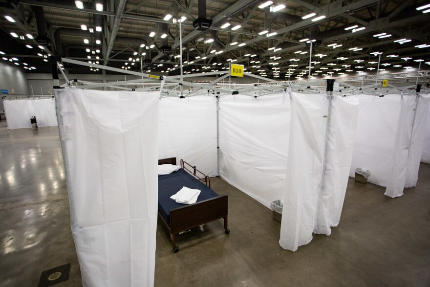 A bed in a field hospital set up at the convention center