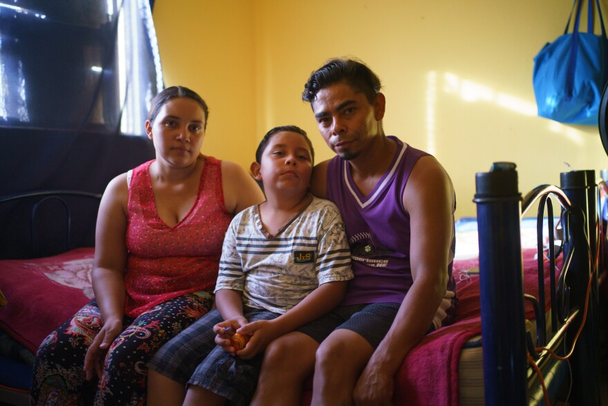 Cesar Pinell, 35. his wife Carolina, 25 and their son Donovan, 9, from Nicaragua are pictured in their room at Pan de Vida Migrant Shelter in Ciudad Juárez, Mexico.