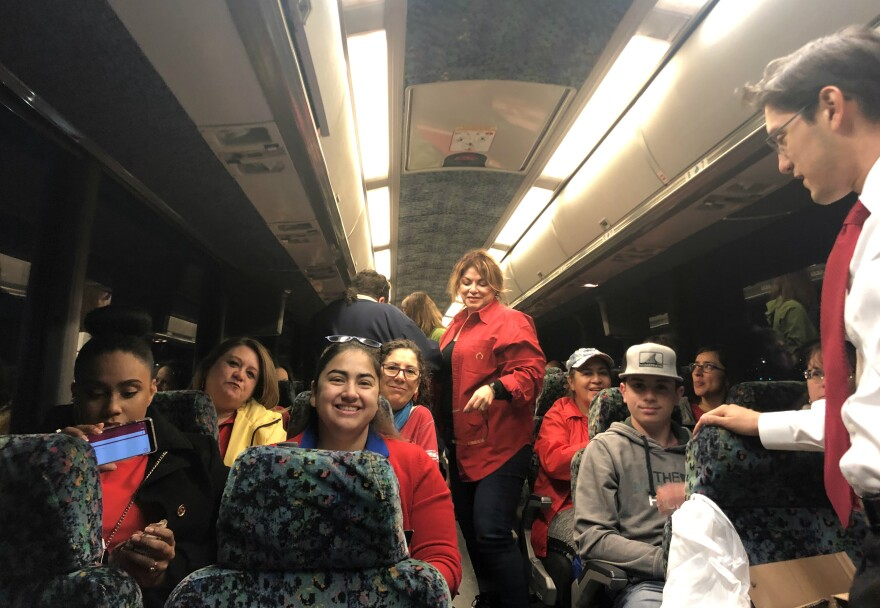 Teachers from San Antonio ISD aboard a bus to Austin Mar. 11, 2019.