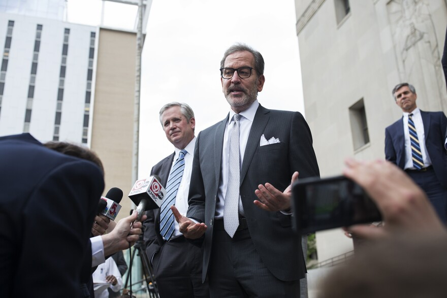 Scott Rosenblum, center, and Jim Bennett, left, Gov. Greintens' defense attorneys, answer questions outside the Civil Courts building on May 14, 2018.