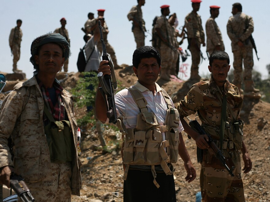 Militants loyal to Yemen's President Abed Rabbo Mansour Hadi take their positions in Taiz, Yemen, late last month after at least 45 people were killed in north Yemen after an airstrike hit a camp for internally displaced people.