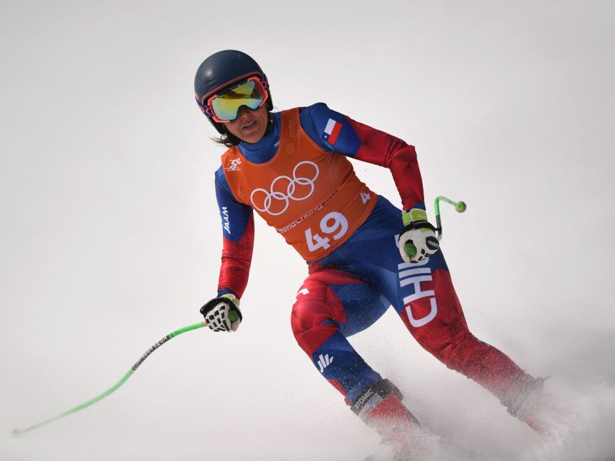 Skier Noelle Barahona of Chile crosses the finish line of the second training of the Alpine skiing women's downhill race on Monday.