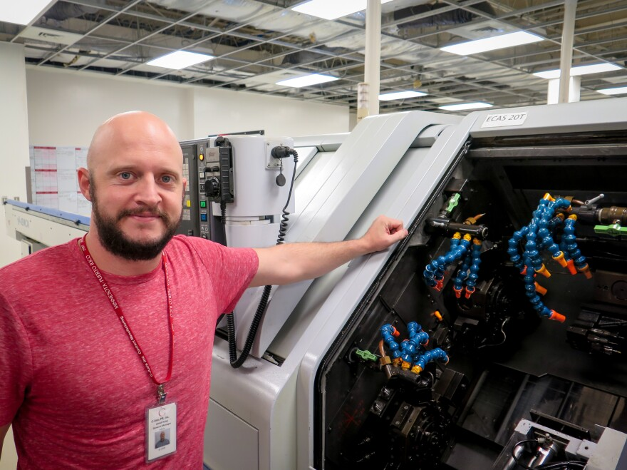 Jared Haley, general manager of the C-Axis plant in Caguas, Puerto Rico, says computer-operated milling machines like this one can cost more than a half-million dollars. Heat and humidity in the plant after Hurricane Maria left many of the machines inoperable, Haley says.