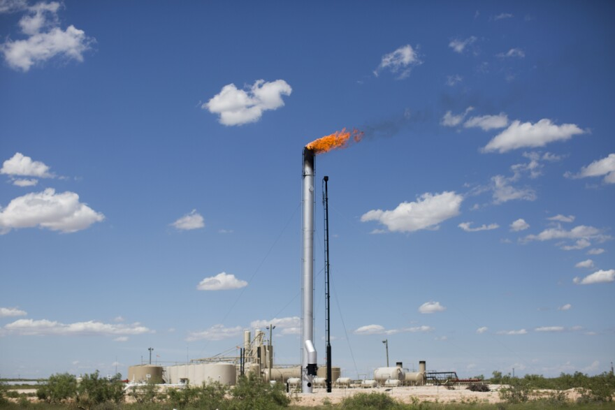Gas is burned off from an oil well in West Texas.