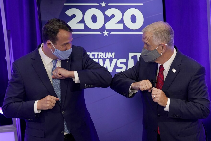 Democratic challenger Cal Cunningham, left, and U.S. Sen. Thom Tillis, R-N.C. greet each other after a televised debate Thursday, Oct. 1, 2020, in Raleigh, N.C.