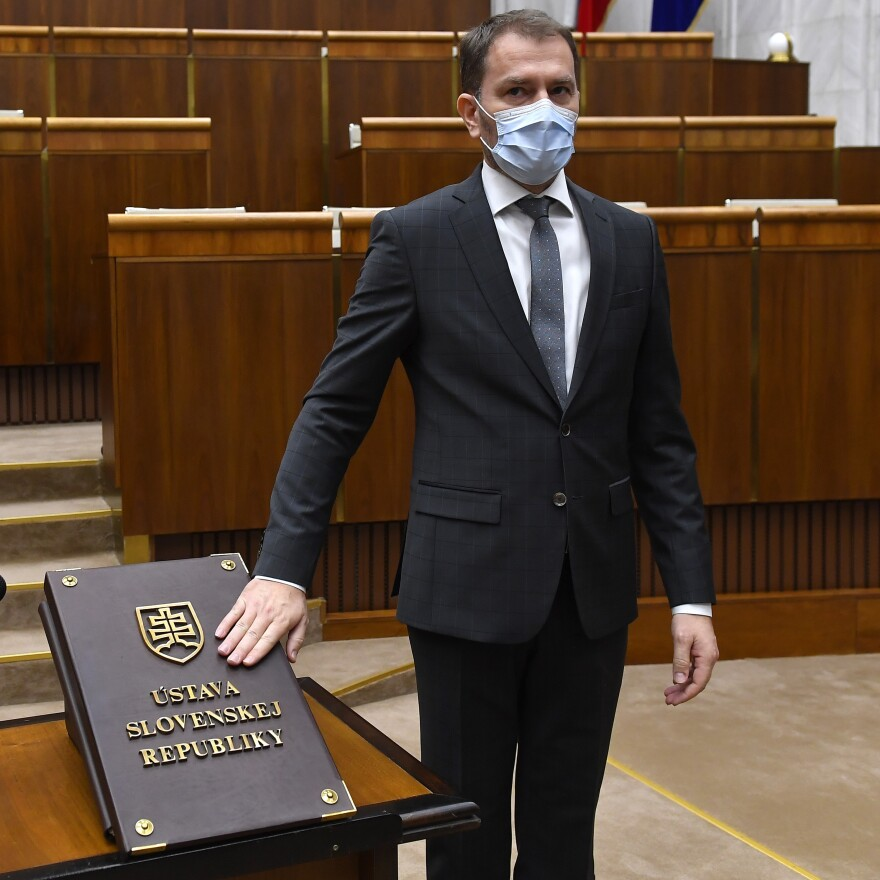 Slovakian Prime Minister Igor Matovic, while wearing a face mask, takes the oath during the inaugural session of the new Parliament in Bratislava last month.