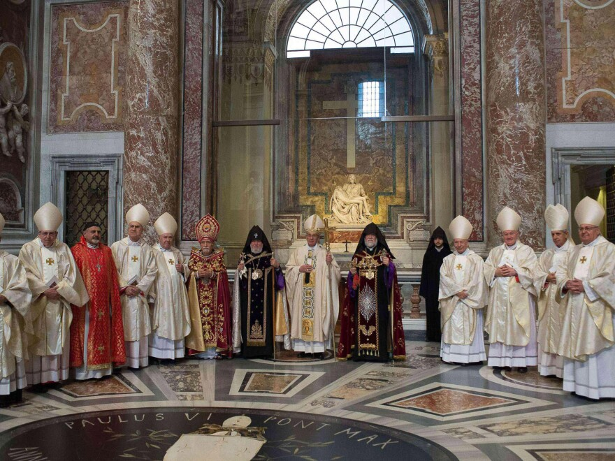 """Pope Francis (center), flanked by the head of Armenia's Orthodox Church Karekin II (seventh left) and Catholicos Aram I (sixth right), celebrated an Armenian-Rite Mass in St. Peter's Basilica in April 2015. Pope Francis called the slaughter of Armenians by Ottoman Turks """"the first genocide of the 20th century,"""" sparking a diplomatic rift with Turkey."""