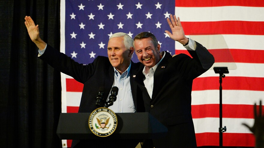Vice President Mike Pence and gubernatorial candidate Ed Gillespie, R-VA, wave during a campaign rally Saturday at the Washington County Fairgrounds in Abingdon, Va.