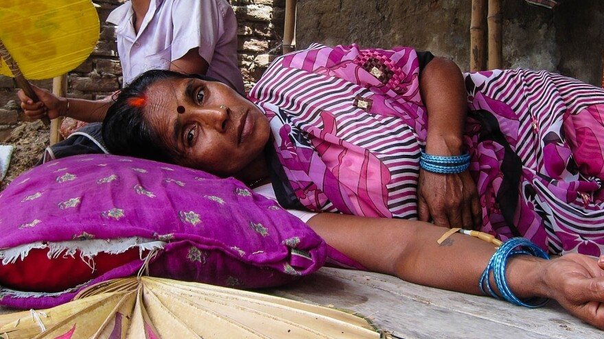 Chandra Devi lost two of her children last week when they consumed a free school lunch in Gandaman village, India. They were among 23 children who died in the tragedy.