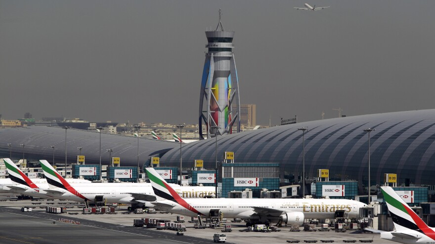 Emirates passenger planes are parked at their gates at Dubai International Airport in the United Arab Emirates. The U.S. restrictions require most electronic devices, including laptops, tablets and cameras, to be placed in checked baggage on direct flights to the U.S. from eight mostly Muslim countries, including the UAE.