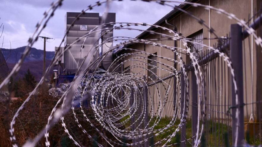 This building is surrounded by the type of barbed wire that makes it difficult to climb over a fence. (Undated image)