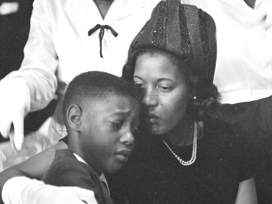 Medgar Evers' widow, Myrlie, comforts the couple's 9-year-old son, Darrel, at her husband's funeral in Jackson, Miss., on June 15, 1963.